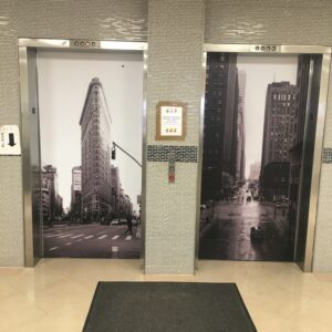 street style sign elevator wraps